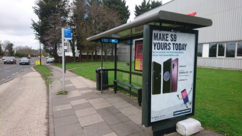 Bus stop in crawley with flag and electronic display