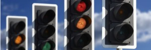 Traffic Lights in row showing red, amber and green